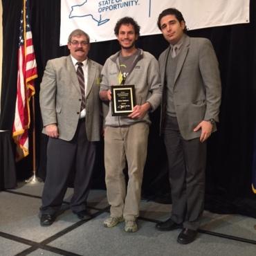 Dave Tedeyan receives his award